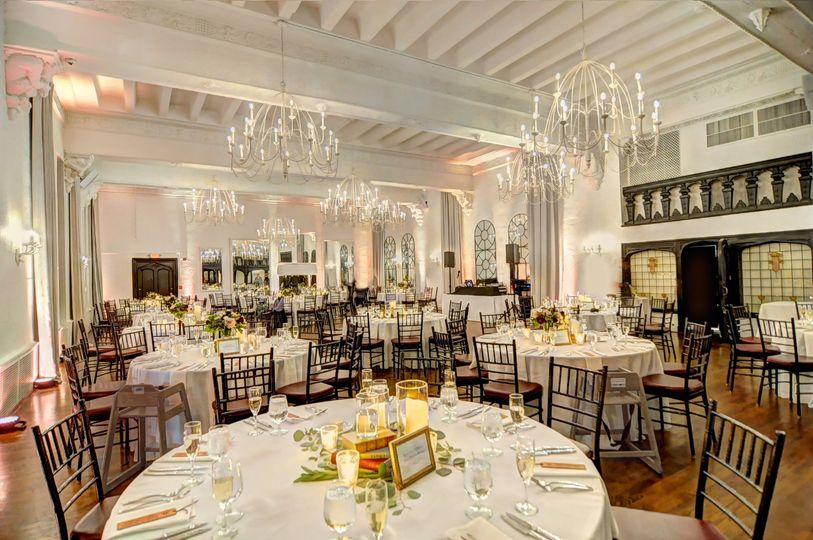 alden castle vintage ballroom light and airy reception set from corner book centerpieces edson dias photography 51 3759
