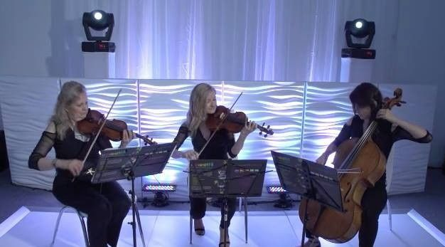String trio performing at an elegant, beautifully lit event in eastern long island