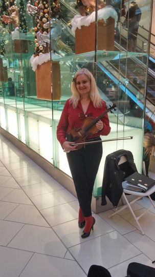 Capriccio ensemble's solo violinist at a christmas event