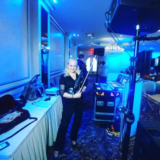 Electric violinist getting ready for an event