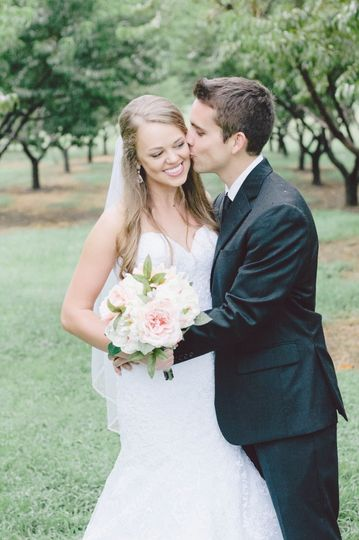 Newlyweds in the orchard