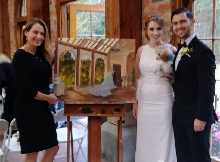 Mr. & Mrs. Lewis by their painting