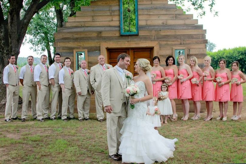 Couple with bridesmaids, flower girl and groomsmen
