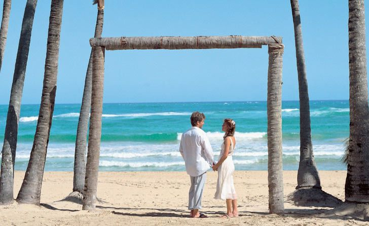 Couple on the beach - Journey to Paradise Travel & Tours