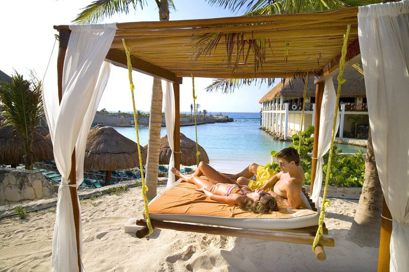 Relaxing on the beach - Journey to Paradise Travel & Tours