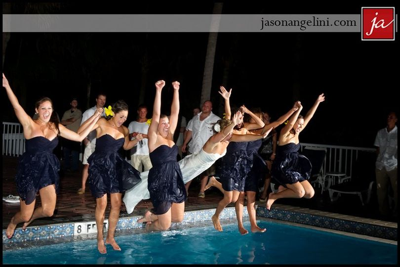 Bride and bridesmaids jump into the pool