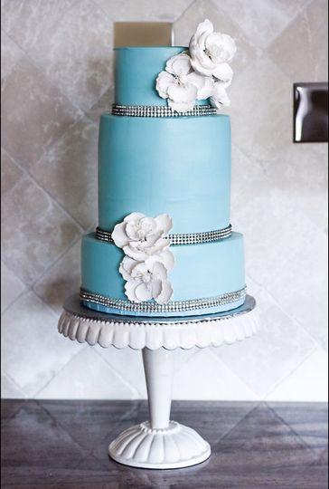 Elegant three (3) tier Tiffany Blue wedding cake. White almond w/raspberry filling. Double barrel...