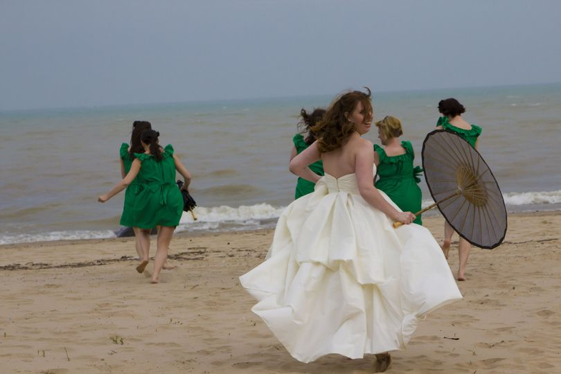 Bride and bridesmaids running at the beach, milwaukee, lake michigan