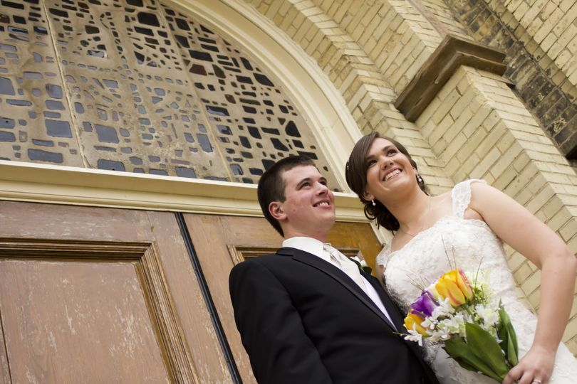 Bride and groom in front of the church, Madison, doors,