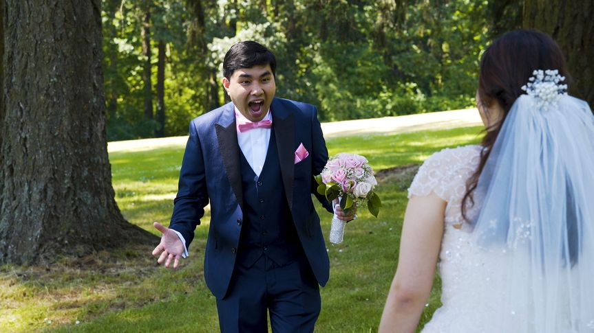 What a reaction!  Seeing his bride for the first time in her wedding dress.
