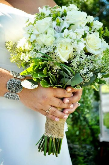 Classy white, ivory and natural green bouquet.. ..escimo roses, white stock, queen anne's lace, bear...