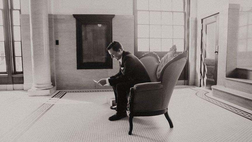 Groom reading love letter