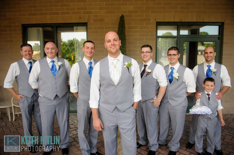 The groom with his groomsmen and ring bearer