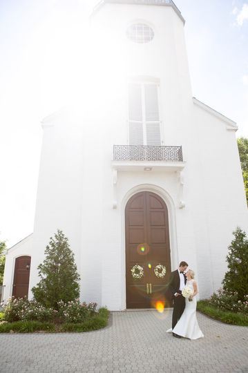 Couple standing in front of a church