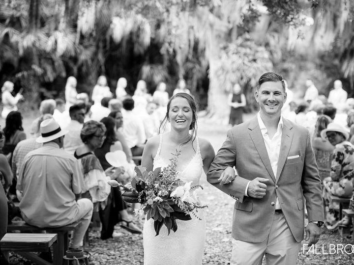 Tmx Couple Smiling Recessional Walk 51 626069 159890115342149 Sarasota wedding officiant