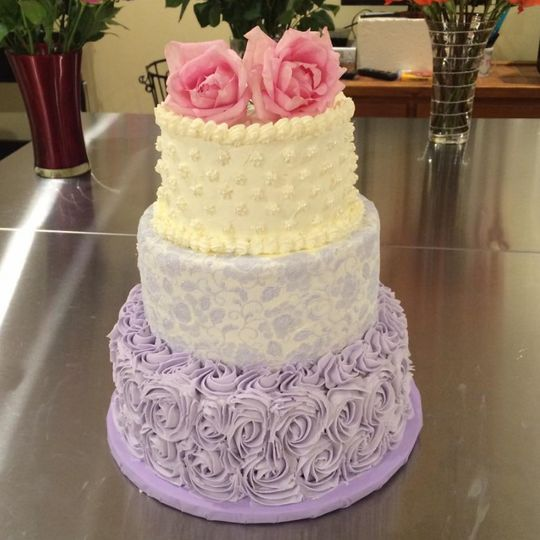 Lavender Wedding cake with rosettes and edible lace
