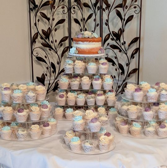 Cupcake table with small naked cutting cake