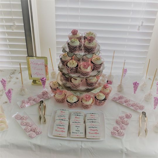 Intimate dessert table with cupcakes, macaroons, merigune cookies and cake pops