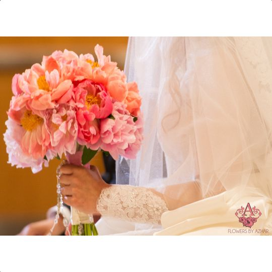 Who doesn't love a beautiful bridal bouquet made of peonies?!