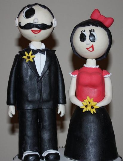 Baltimore's iconic couple custom made from fondant.