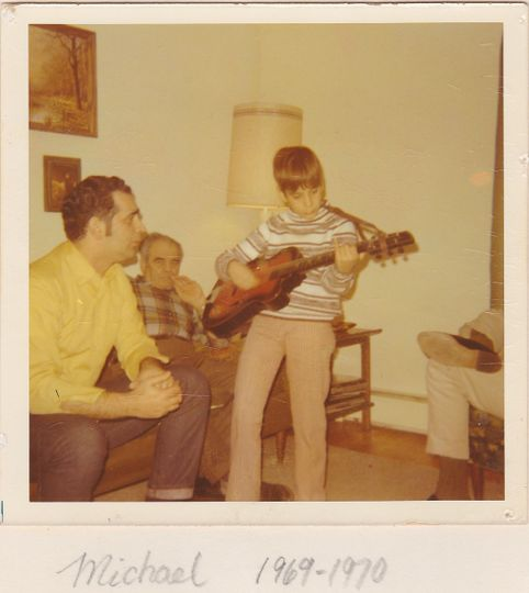 Playing Guitar at age eight!