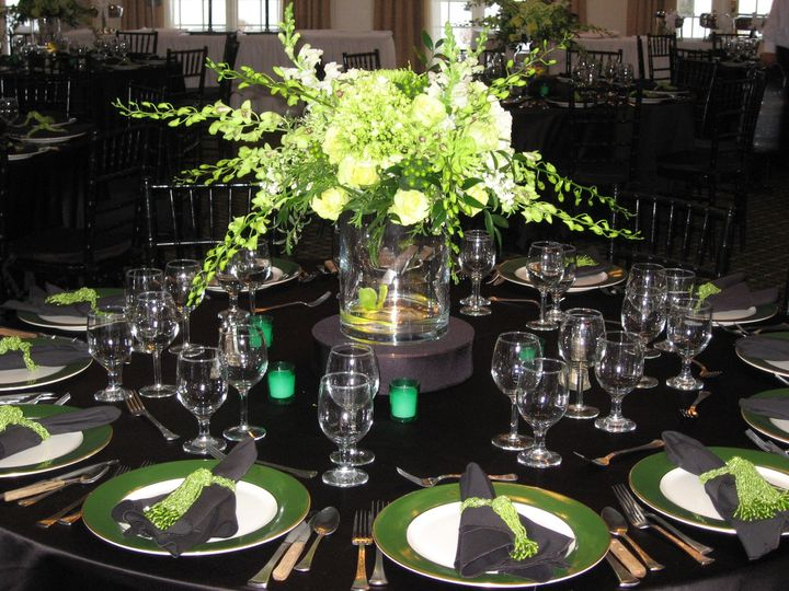 Black table setting with green decor