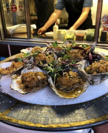 Oysters with dirty rice butter