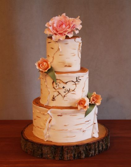 Naked wedding cake with heart carving