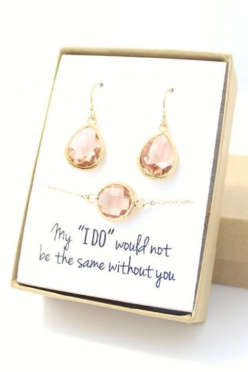 This peach champagne/gold teardrop earrings & bracelet set necklace is only $44 and can be...
