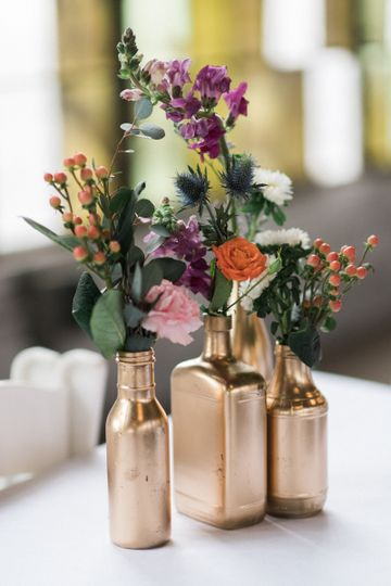Flowers in tiny rose gold vases