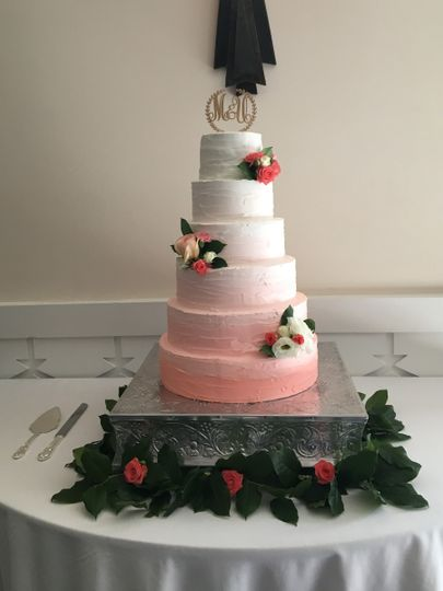 Pink gradient wedding cake with flowers