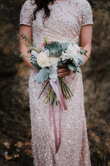 Holding a bouquet | Photo by Lavel Marie Photograhy