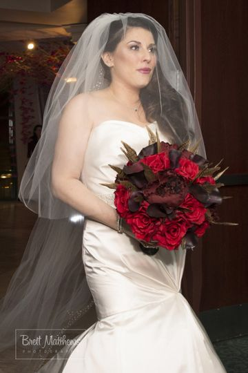 Bride with red flowers