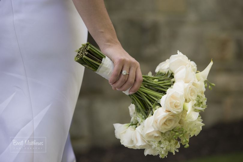 Holding white bouquet