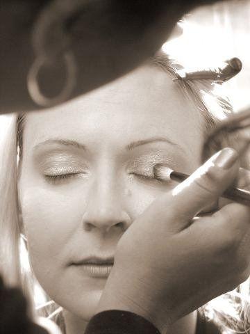 Applying eye shadow on wedding day.