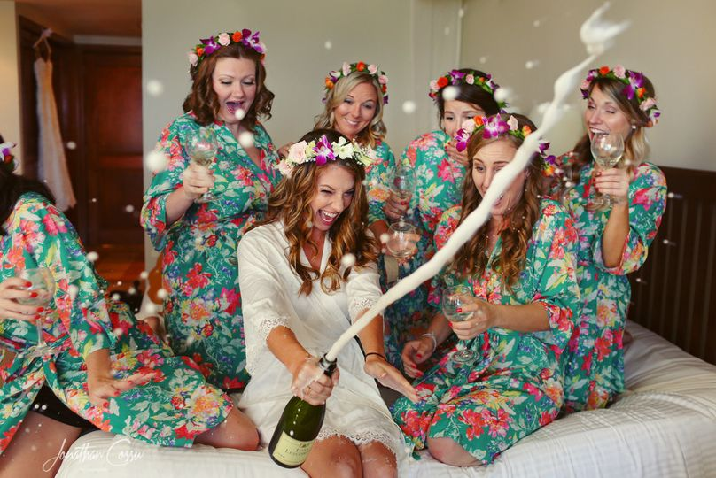 Bride popping the bubbly with her bridesmaids. Now Sapphire Riviera Cancun Wedding in Mexico