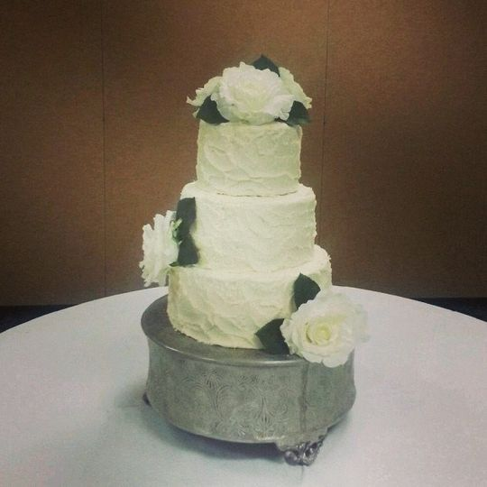 Textured White Wedding Cake with flowers.  At the Shrine in Belleville