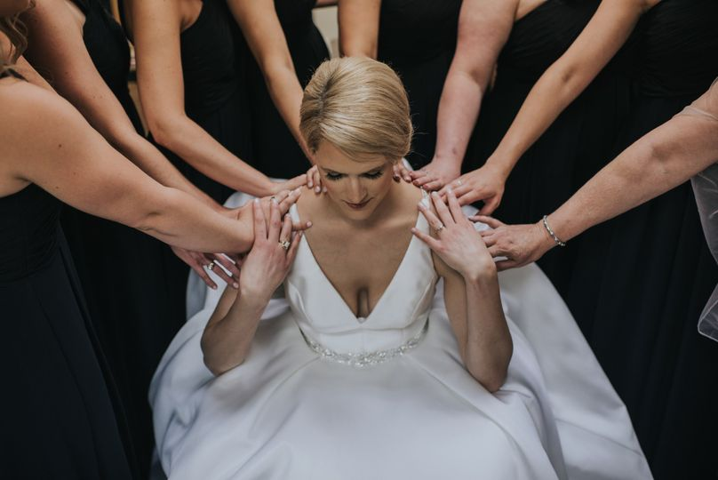 Praying with her bridal party