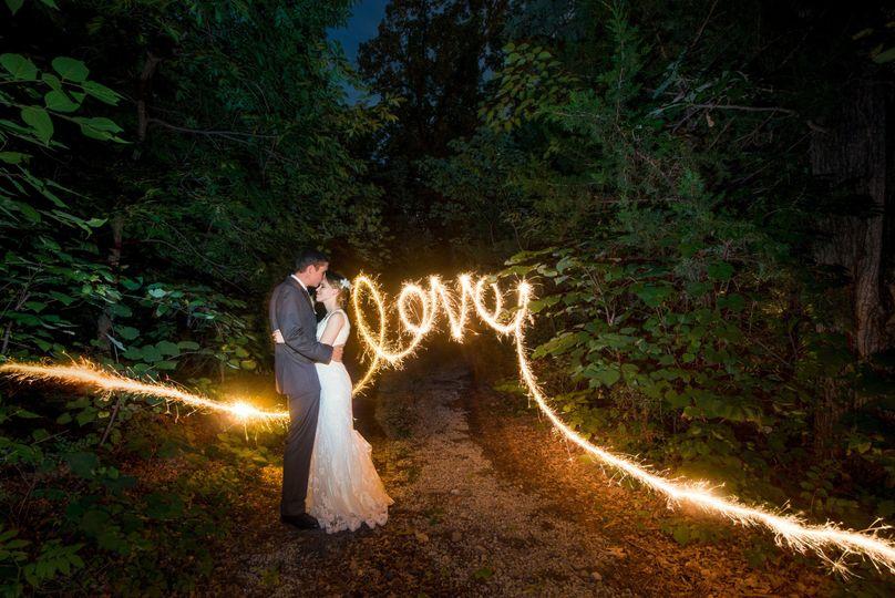bride and groom love sparkler writing