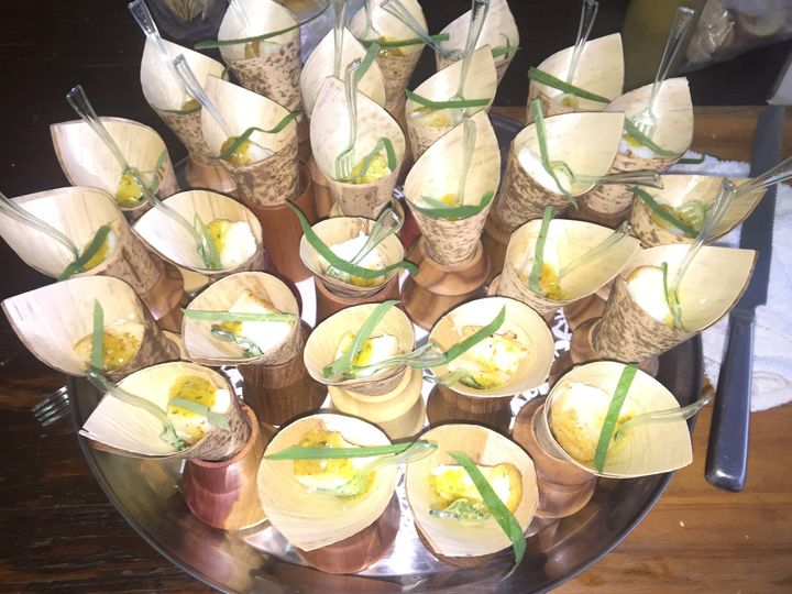 Local Macadamia crusted grouper in bamboo cups over a citrus salad