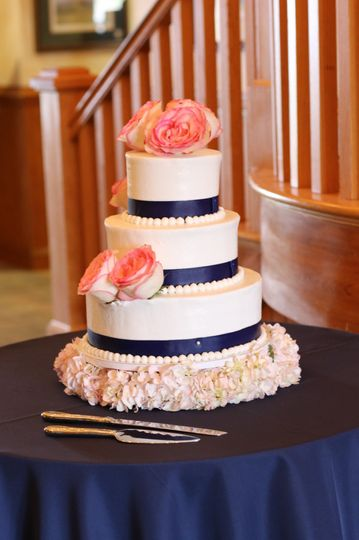 White cake with navy blue ribbon
