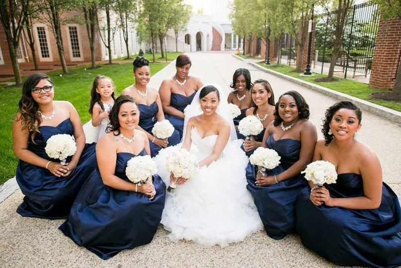 Bride and her bridesmaids sitting down
