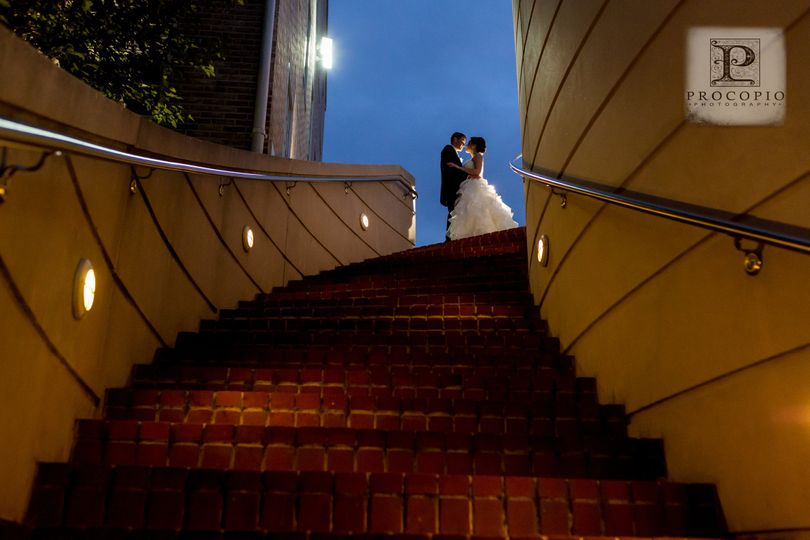 Newlyweds at the top of the stairs