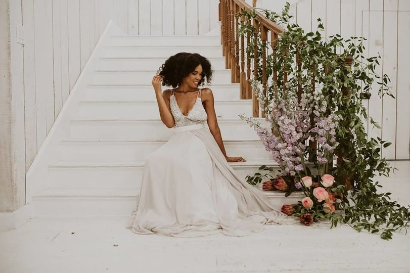 Bride on stairs with floral decor