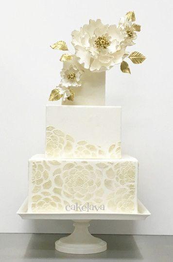 Three layered wedding cake with white flowers