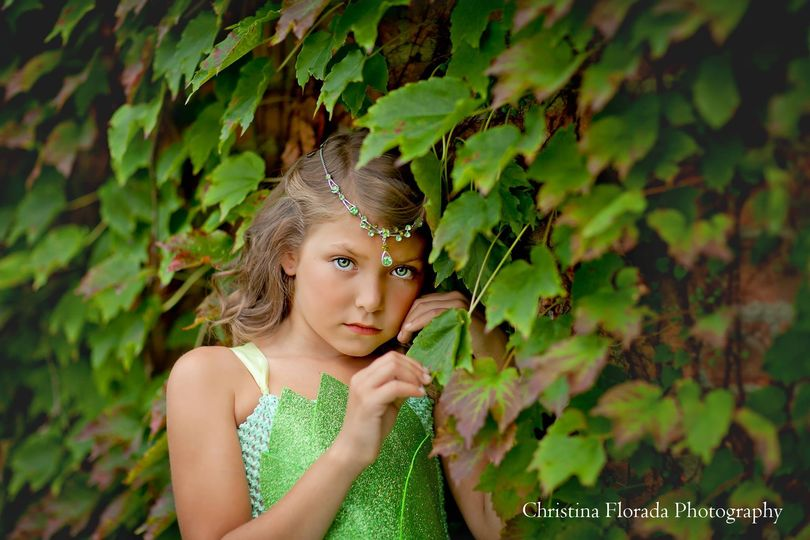Flower girl by the green wall