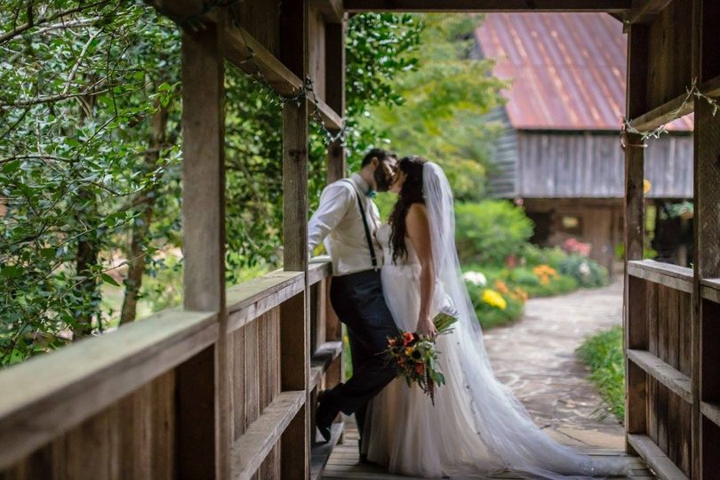 Couple kissing in the barn
