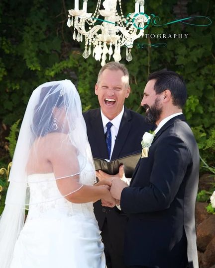 Officiant sharing the happy moment