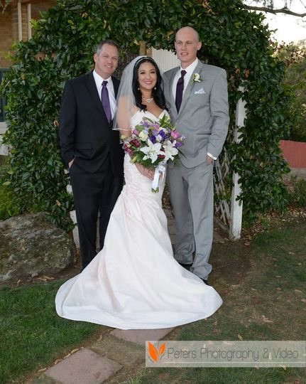Officiant photo with newly wed couple