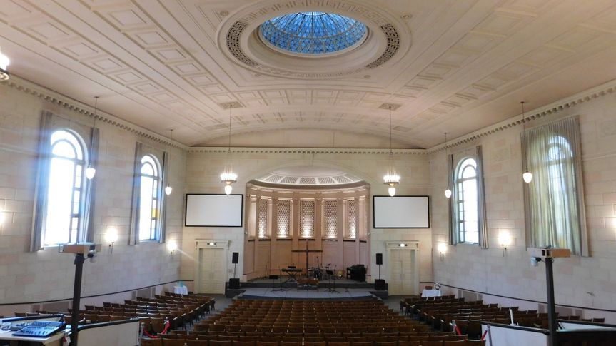 Main sanctuary with arched windows and domed skylight